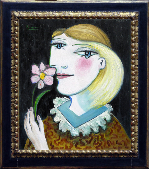 Woman with a pink flower