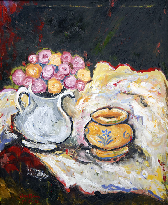 Roses and small pot on a table