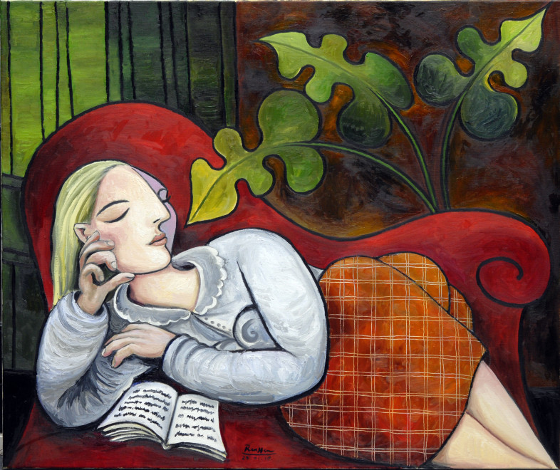 Woman with book on a couch