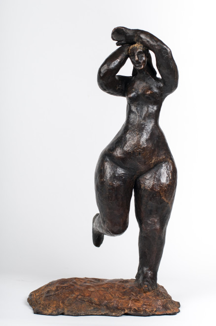 Nude with arms above her head