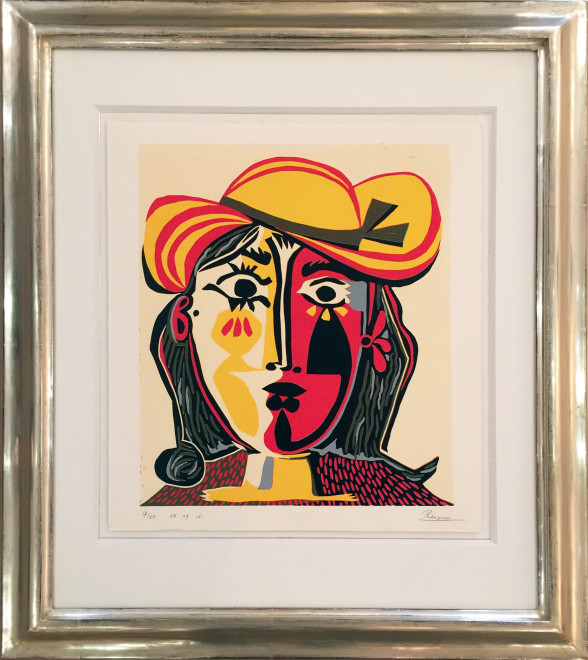 Woman in a red and yellow hat