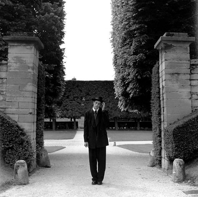 Rodney Smith, Man Standing at Entrance, Parc de Sceaux, France, 1995