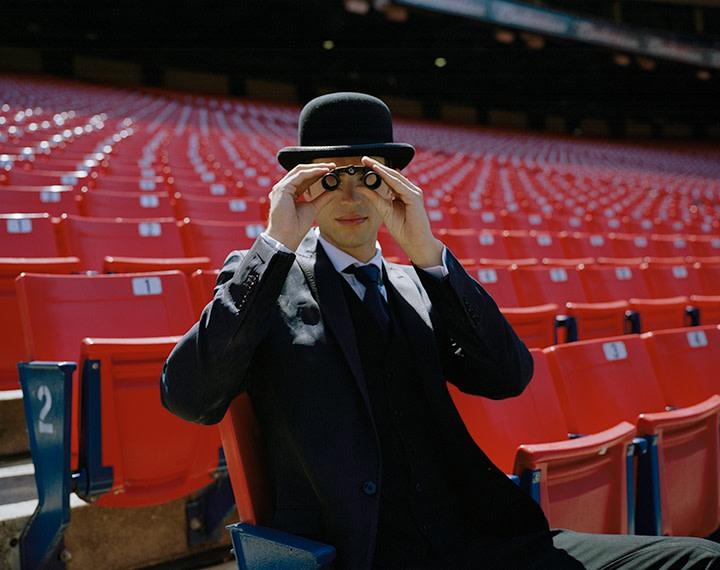 Andrew Seated in Stadium, New York, New York