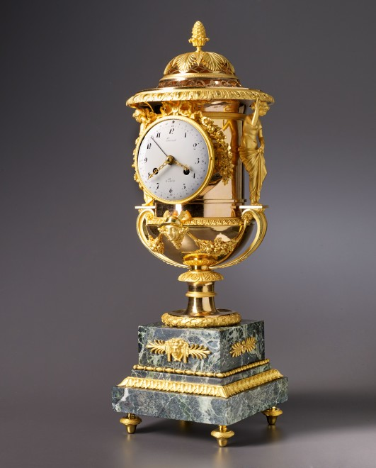 An Empire Medici vase-shaped mantel clock by Laurent à Paris housed in a case attributed to Pierre-Philippe Thomire