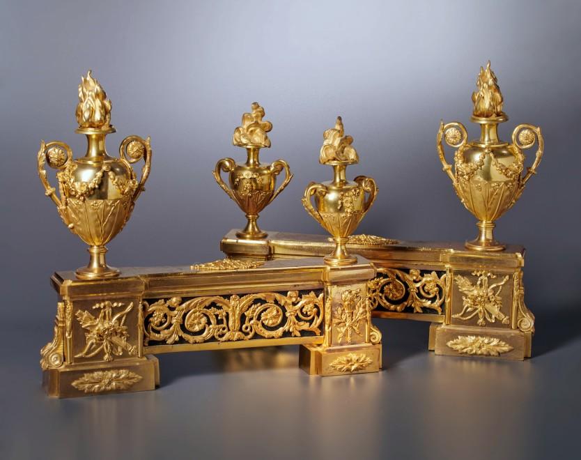 A pair of Louis XVI gilt bronze chenets