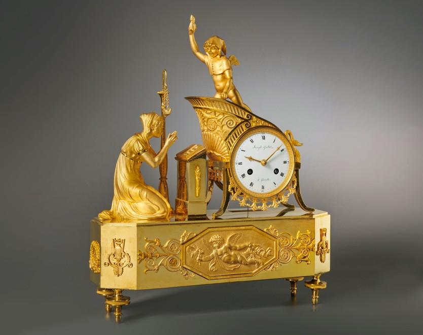 A Charles X gilt bronze mantel clock by Joseph Guillet