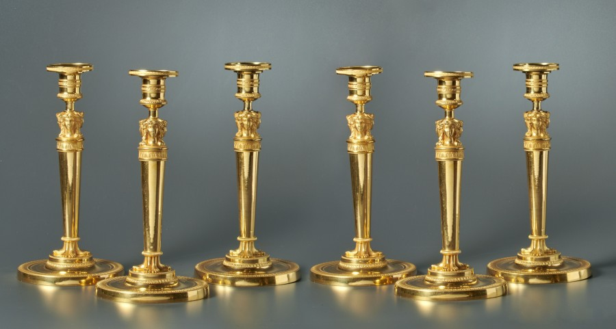 A set of six Empire candlesticks