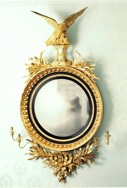 A Regency mirror fitted with a pair of two-light candelabra