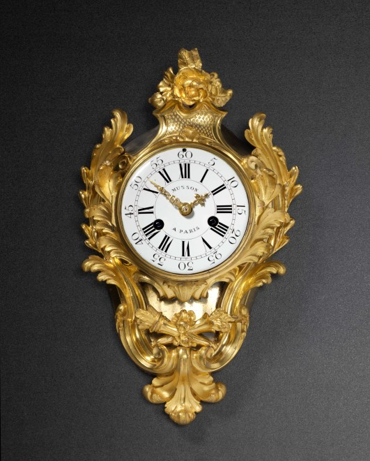 A small late Louis XV gilt bronze cartel clock with movement by Pierre Musson, case attributed to Jean-Joseph de Saint-Germain