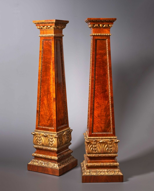 A pair of Regency carved pedestals