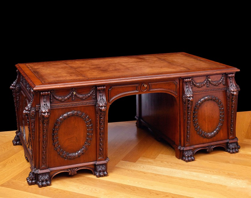 An English mid Twentieth Century partners' pedestal desk, attributed to Arthur Brett, after the original designed and made by Thomas Chippendale