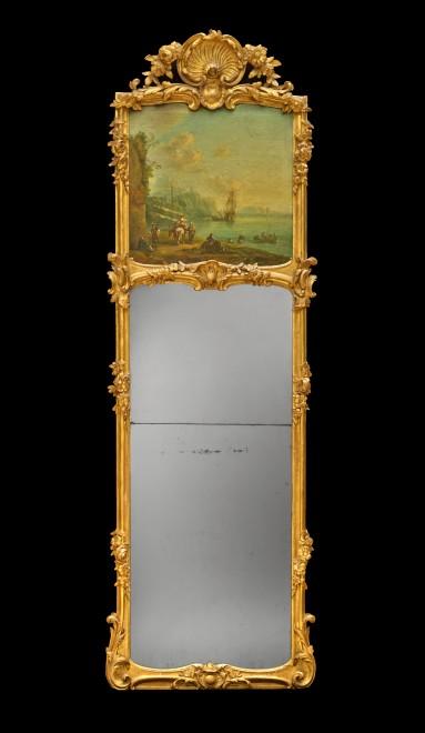 A highly ornate German Louis XV period trumeau mirror