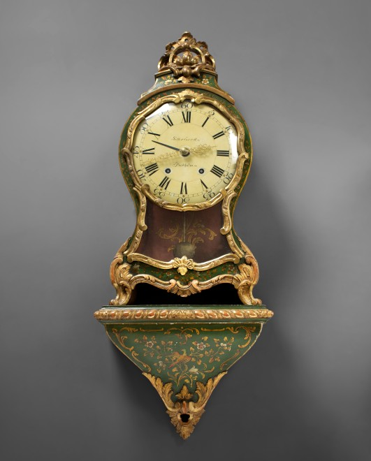 A Swedish Rococo cartel clock with bracket by Petter Ernst