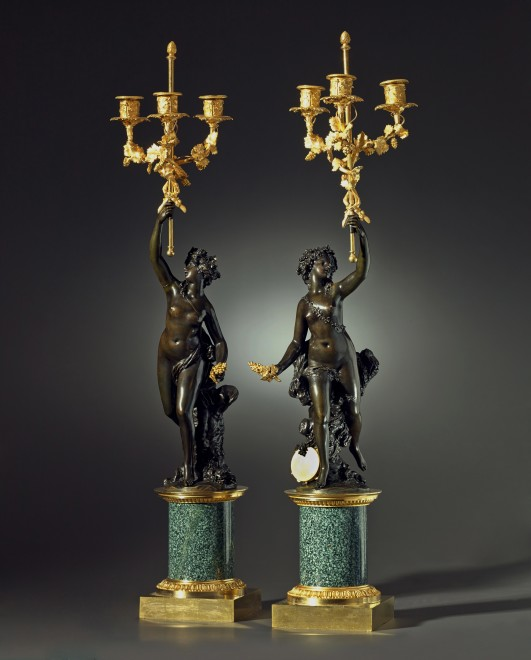 A pair of Louis XVI three-light figural candelabra after a model attributed to Joseph-Charles Marin