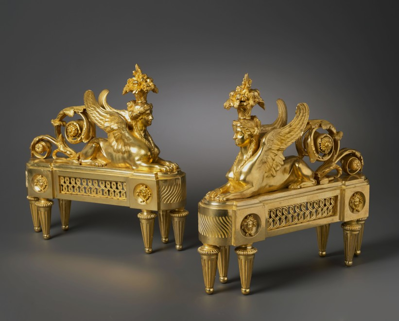 A pair of Louis XVI chenets almost certainly after a design by François-Joseph Bélanger