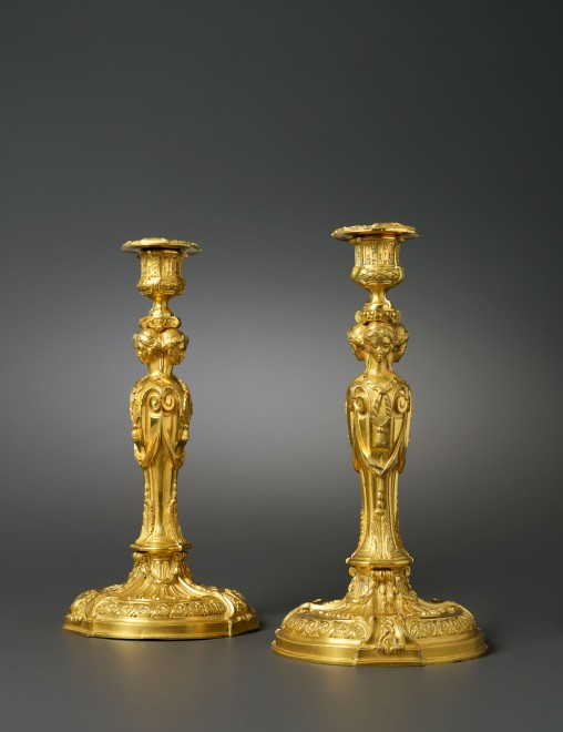 A pair of Louis XVI candlesticks after a model by Jean-Démosthène Dugourc