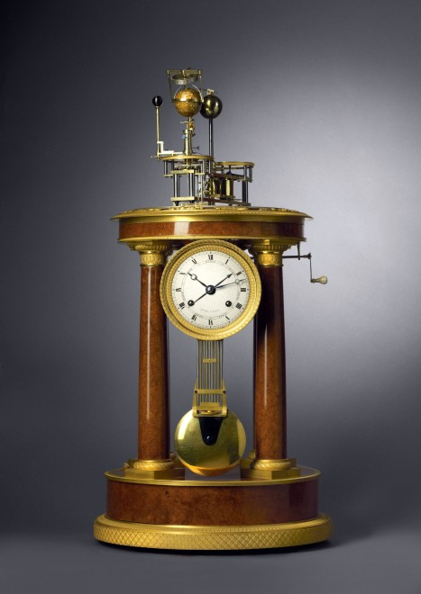 An Empire orrery clock with glass dome by Raingo