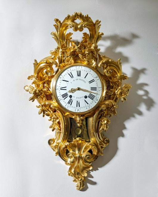 A Louis XV cartel clock of month duration by Jean-Baptiste II Dutertre