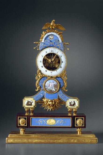 A late Louis XVI astronomical skeleton clock y Lamiral, enamel by Joseph Coteau