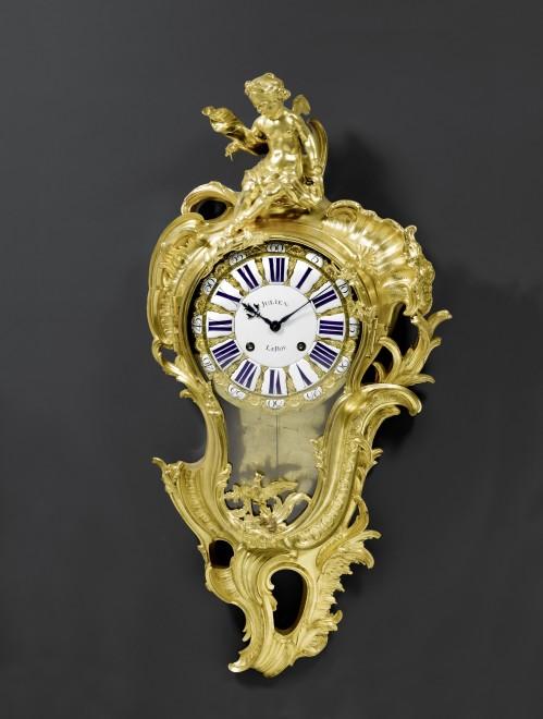 A Louis XV cartel clock by Julien Le Roy, the case almost certainly by Jacques Caffiéri