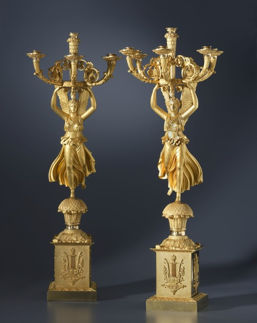 A pair of Empire six-light candelabra by Pierre-Philippe Thomire, after a design by Charles Percier