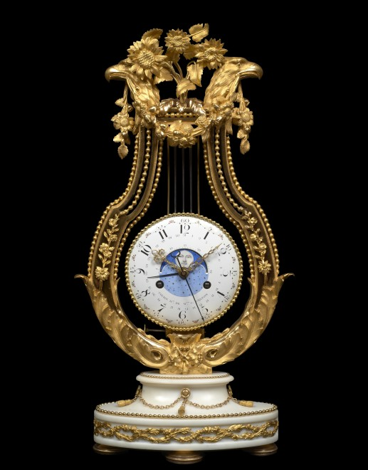 A Louis XVI lyre clock by Joseph-Simon Cousin, the dial with central moon phase by Joseph Coteau