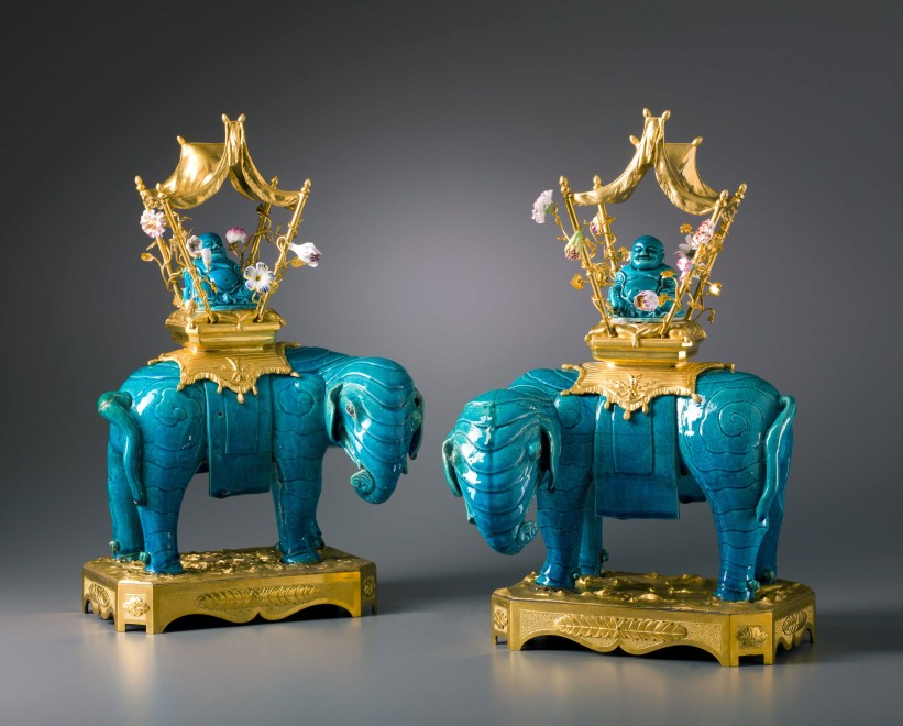 A pair of Louis XV gilt bronze mounted Ming Dynasty elephants with Qing Dynasty Buddhas