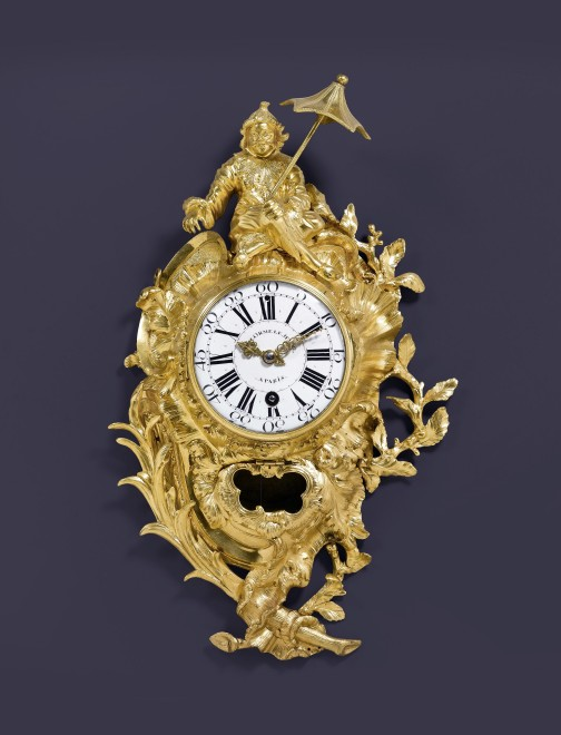 A Louis XV cartel clock of eight day duration by Delorme Le Jeune