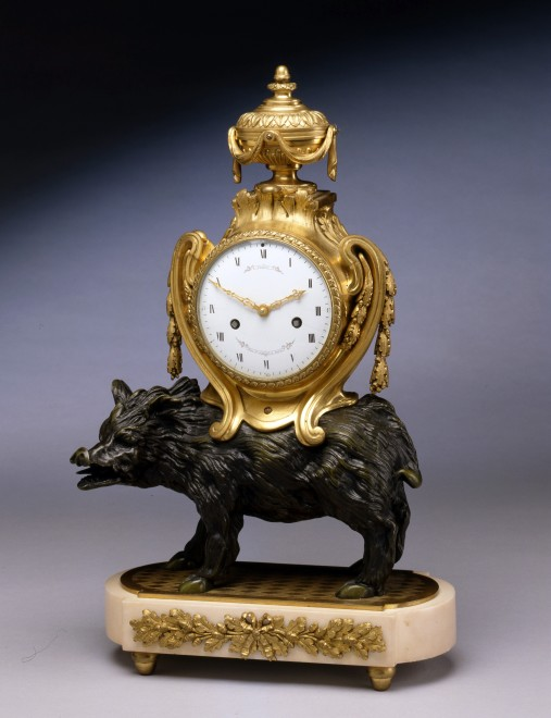 A Louis XVI clock supported on the back of a wild boar by Joesph Coteau