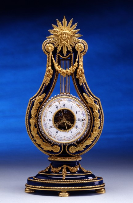 A Louis XVI style lyre clock of two week duration