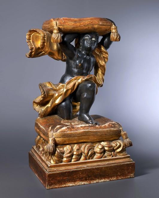 A Baroque style North Italian Blackamoor tabouret
