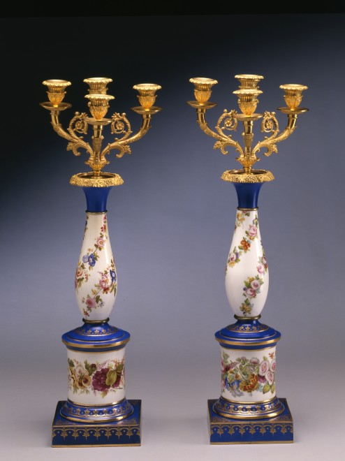 A pair of late Empire three-light candelabra