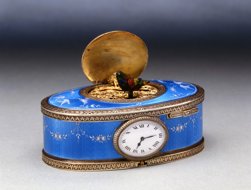 An oval singing bird box with clock, by Paul Leopold Buhré