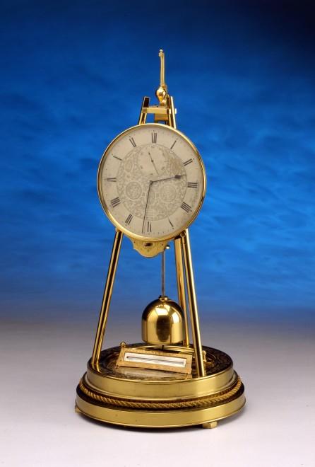 A Victorian tripod clock, by Thomas Cole