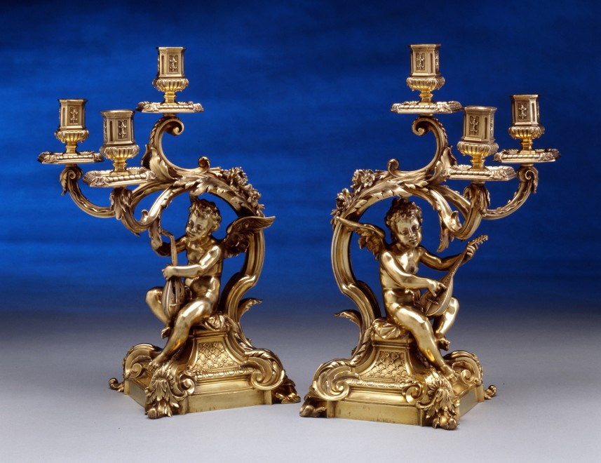 A pair of figural three light table candelabra, by Frederick Boucheron
