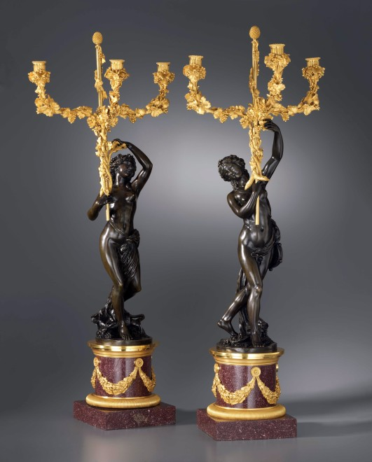 A pair of Louis XVI three-light figural candelabra after a model attributed to Clodion