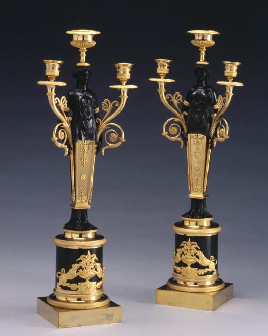A pair of Empire figural three light candelabra