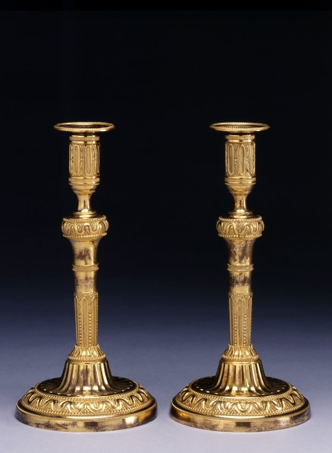 A fine pair of Louis XVI candlesticks