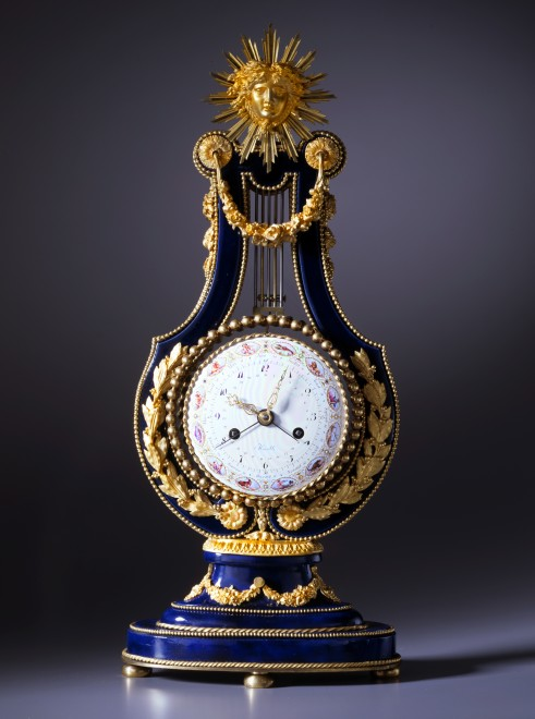 A Louis XVI lyre clock of eight day duration, movement by Kinable the enamel work by Dubuisson