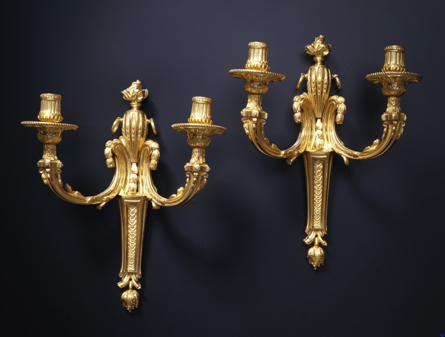 A pair of Louis XVI two-light wall-lights