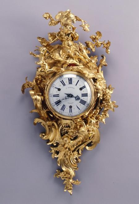 A Louis XV figural cartel clock by Baptiste Baillon, enamel work by Antoine-Nicolas Martinière