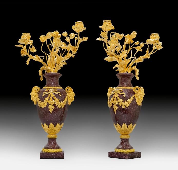 A pair of Louis XVI three-light candelabra