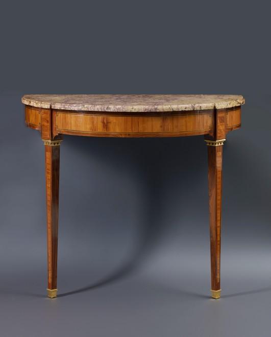 A Louis XVI inlaid demi-lune table