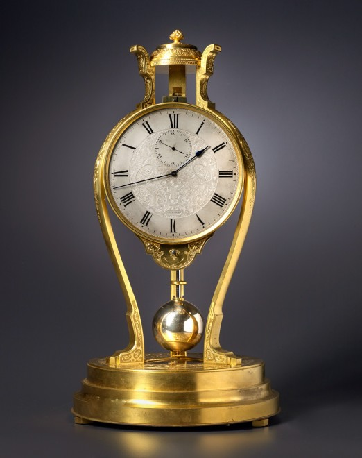A Victorian tripod clock of one month duration made by Thomas Cole and retailed by Hunt and Roskell of London