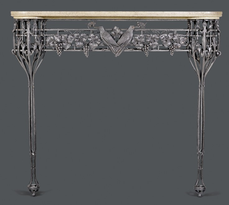 A very fine Art Deco wrought iron mantel piece with shaped, gray / beige stone plate