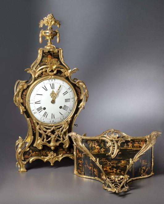 A Louis XV Transitional Louis XVI grande cartel clock with bracket housed in a case by Adrien-Jérôme Jollain