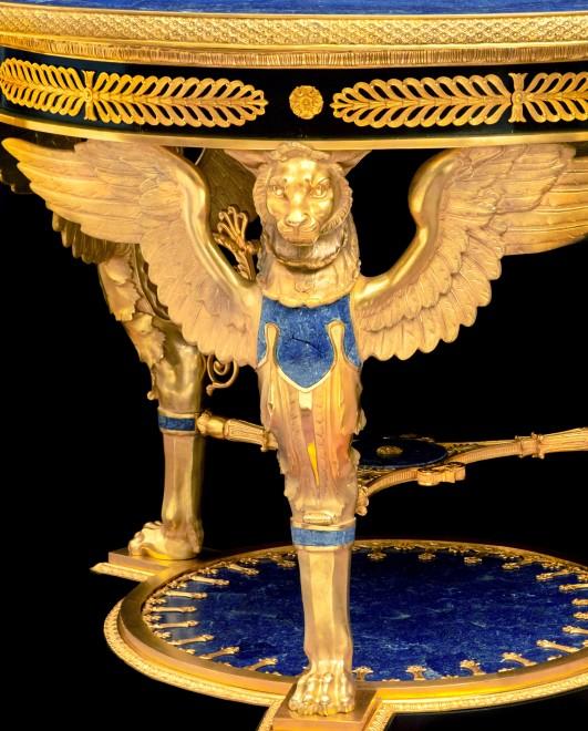 An Italian Empire style gilt bronze and lapislazuli-veneered center table