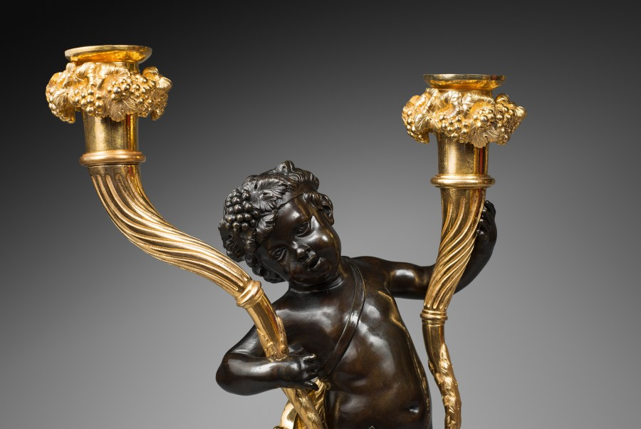 A pair of Louis XVI figural candelabra, attributed to Clodion