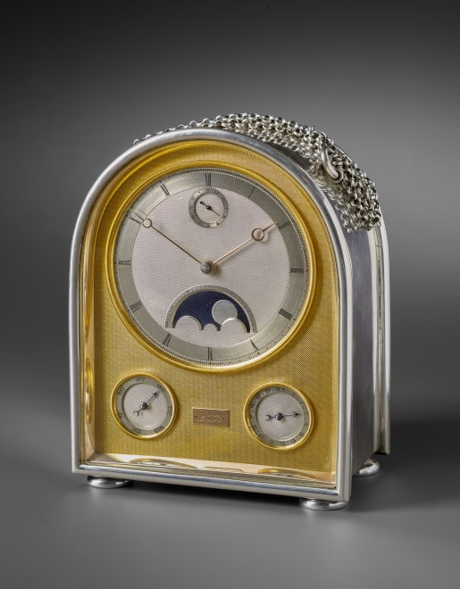 A late 19th century humpback travelling clock with moonphase by Jump