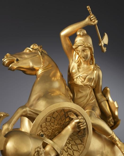 An Empire statuette portraying an Amazonomachy scene